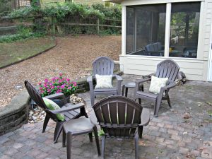 Right now, we have some casual chairs. We'd love to do a fire pit where the flowers are, but the previous owners had a fountain there so there's electrical involved.