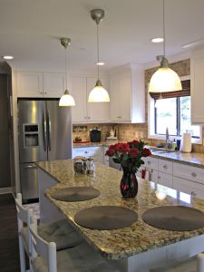 Extended the island the whole length of the kitchen to maximize space.