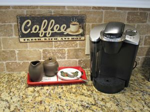 Love our coffee nook. The sign is from World Market and hung with a clear Command Strips tab.