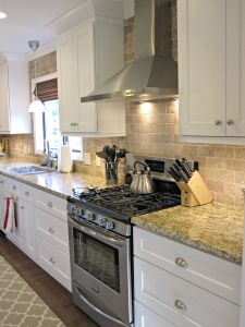 The new Frigidaire gas range and Broan hood. The contractor's idea to tile the full wall and I love it!