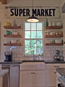 I love Fixer Upper, but I knew lots of of open shelving wouldn't work for me (Photo Credit found here)